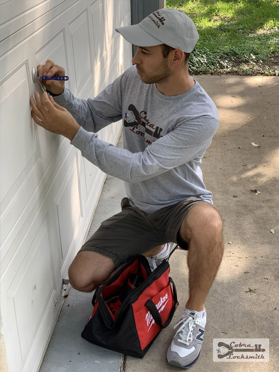 Professional locksmith David lock picking a garage door in Liberty Hill area